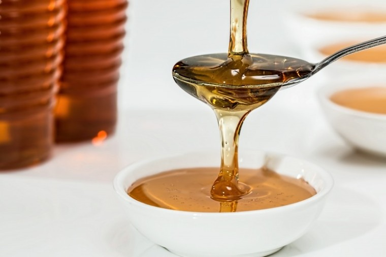 honey-sweet-syrup-organic-golden-teaspoon-pouring.jpg
